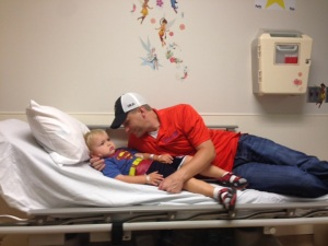 Dad helps AJ wake up from his third MRI since finishing proton therapy.